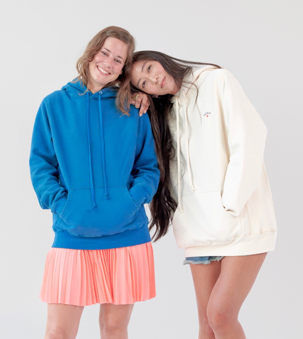 Two models wearing colorful hoodies