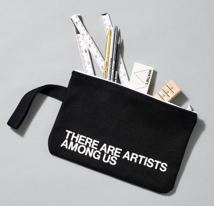 A black pouch with There Are Artists Among Us written in white
