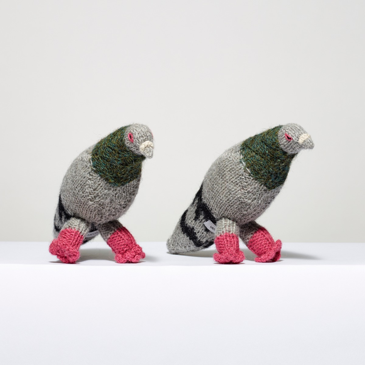 Two pigeons made out of yarn