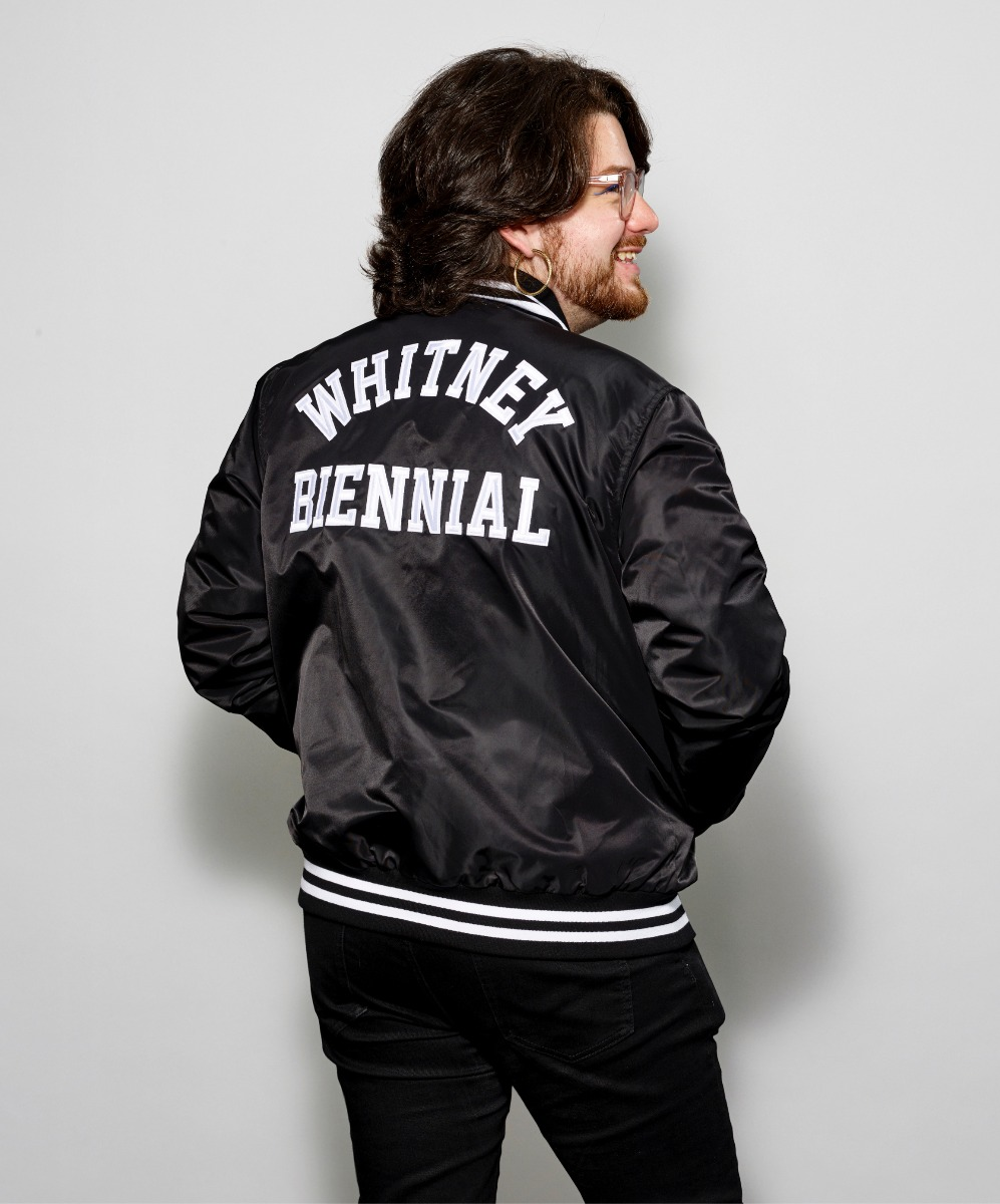 Model wearing Whitney Biennial varsity jacket