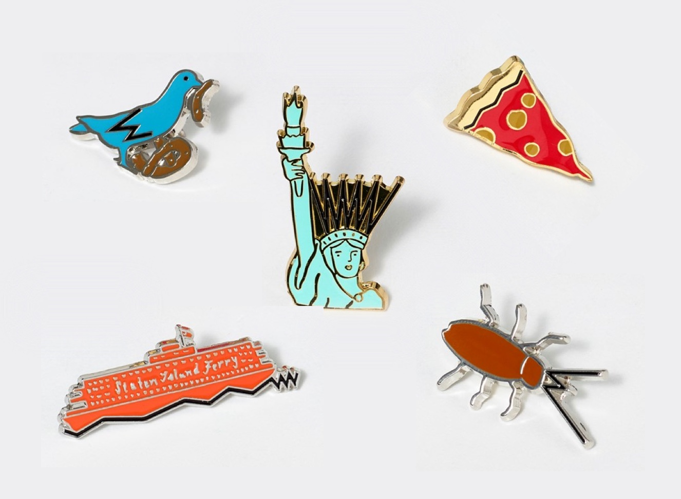 A collection of pins with hand-drawn illustrations