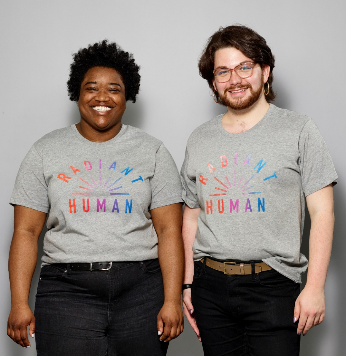 Two models wearing grey shirts with Radiant Human across chest