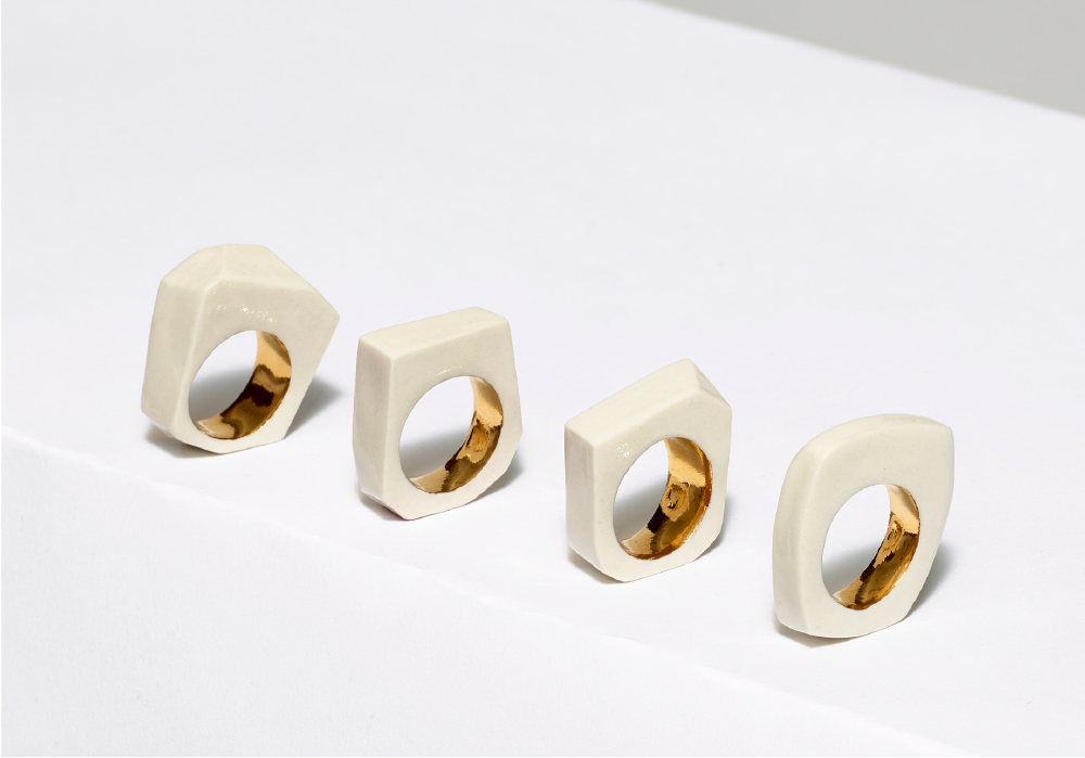 Set of five beige rings with gold set interiors