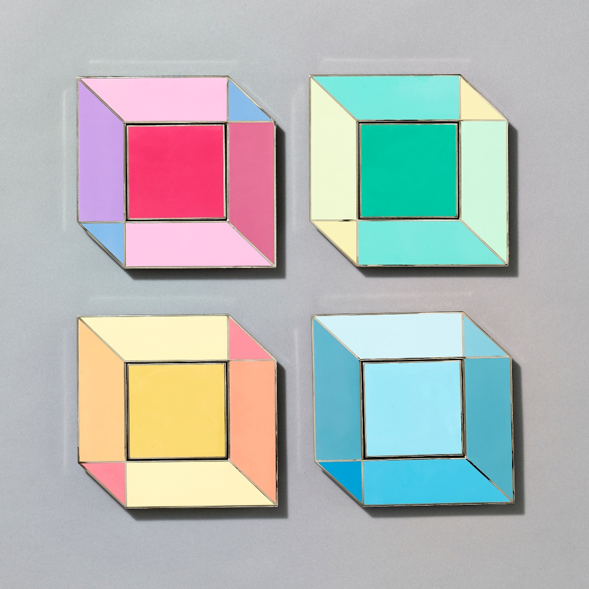 Grid of four different colored square pins