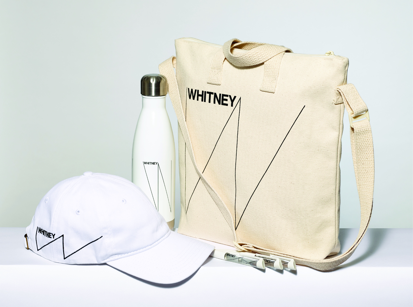 Group of Whitney branded water bottle, tote, and hat