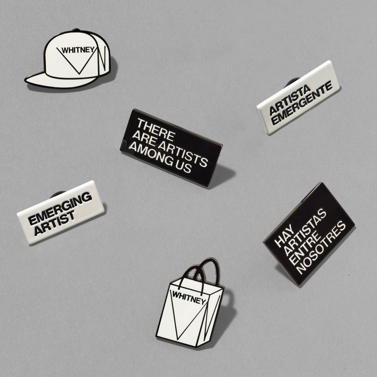 A series of mono-colored enamel pins