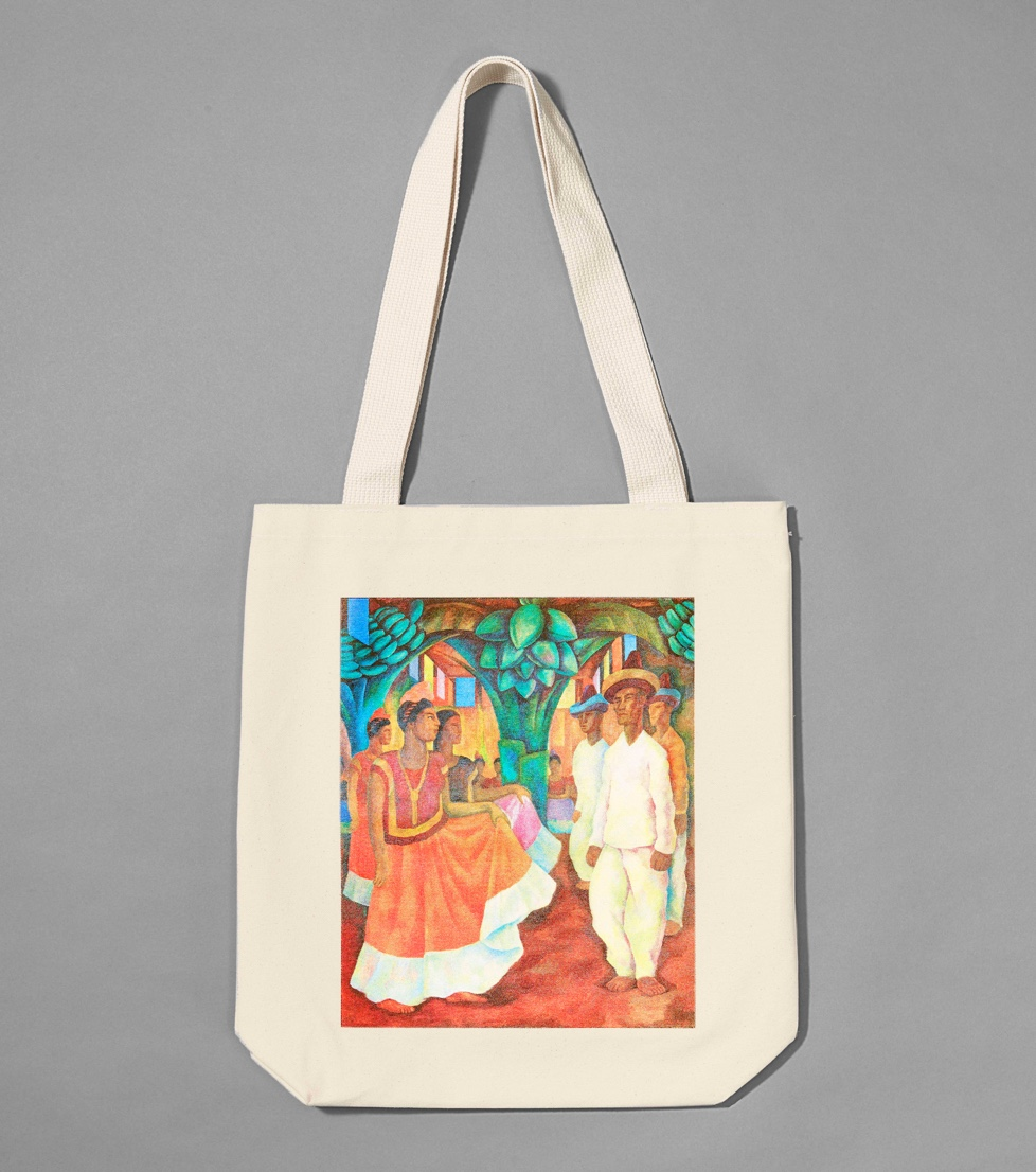 Someone holding a tote bag with a colorful print